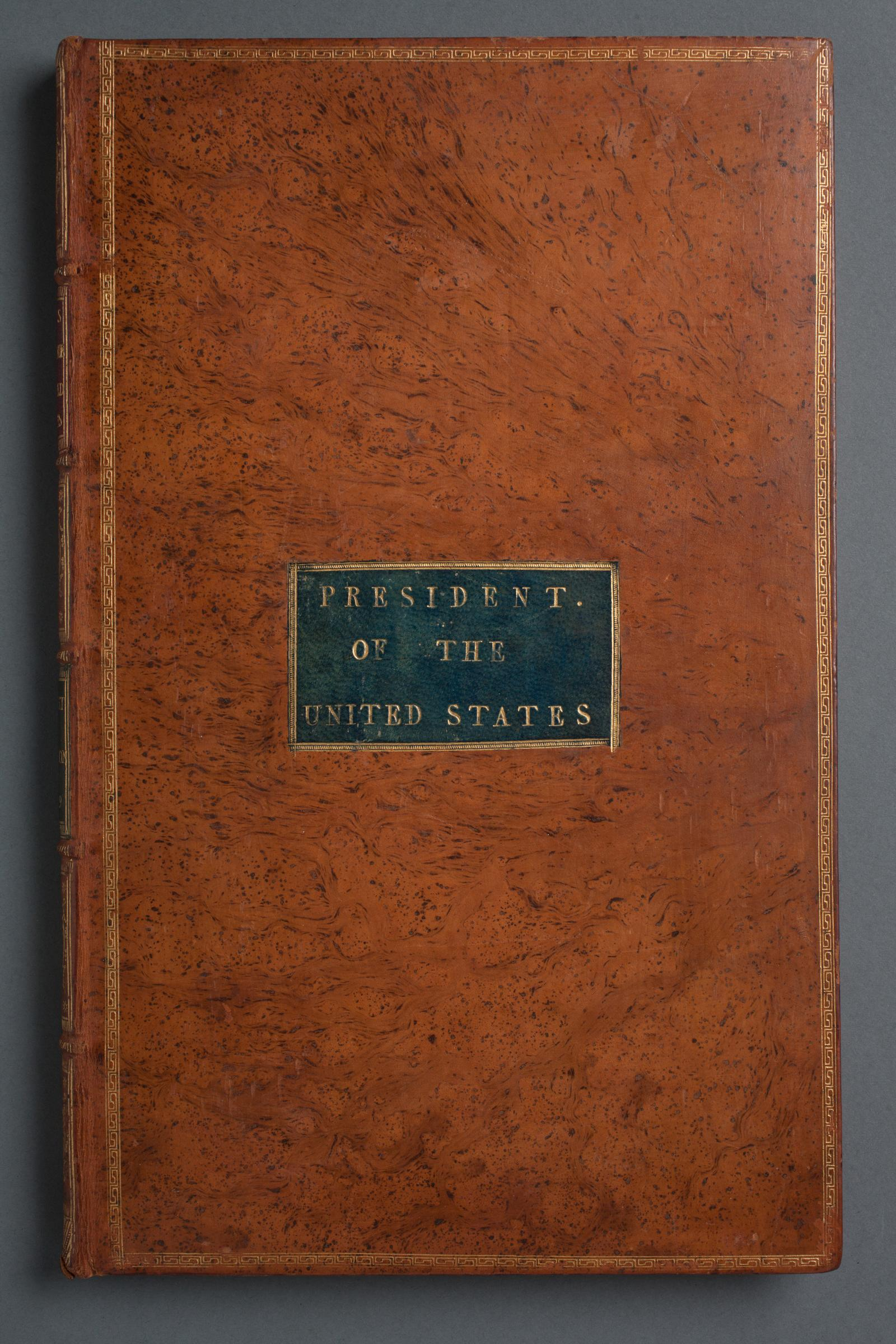 "The cover of George Washington's copy of ""Acts of Congress,"" printed by Francis Child and John Swaine in 1789. MVLA. Click the image to see the full volume."