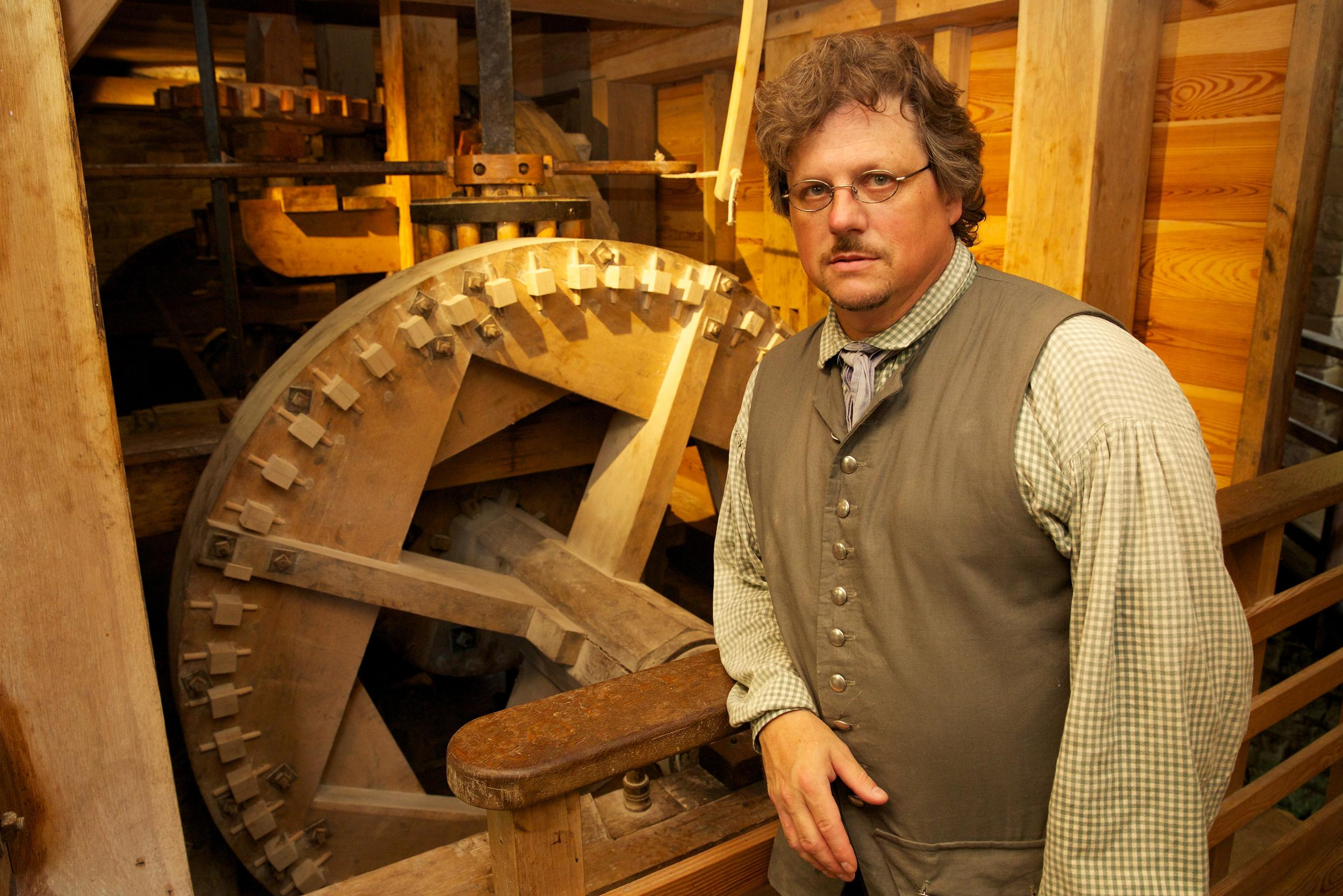 Steve Bashore inside George Washington's reconstructed gristmill.
