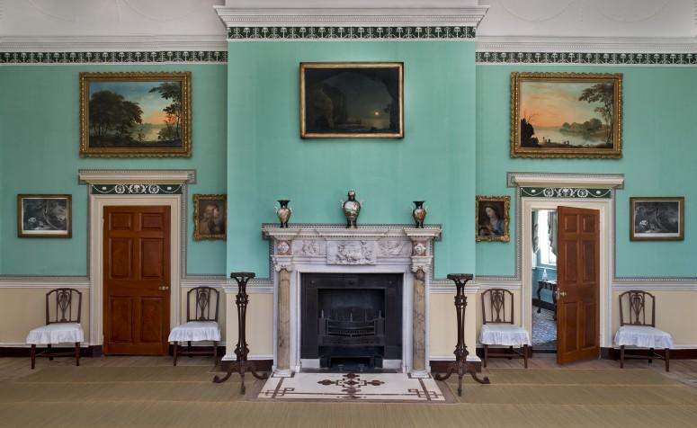 The New Room's south wall, featuring the mantel, porcelain vases, and candlestands. Photograph by Gavin Ashworth.