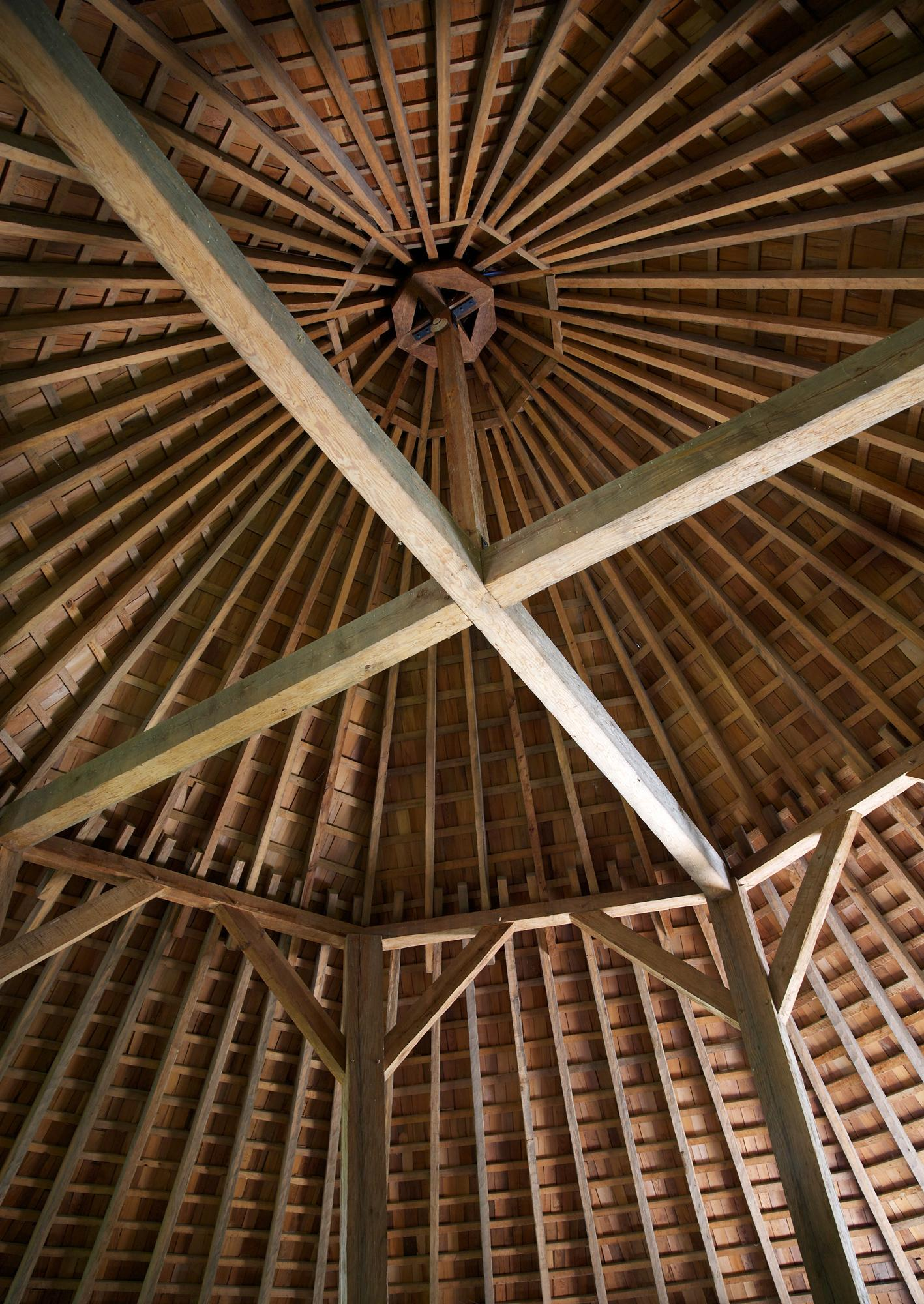 Interior of the 16-sided barn showing the roof's framing. - MVLA