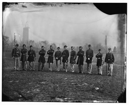 Union army officers posing in front of the unfinished Washington Monument, Library of Congress.
