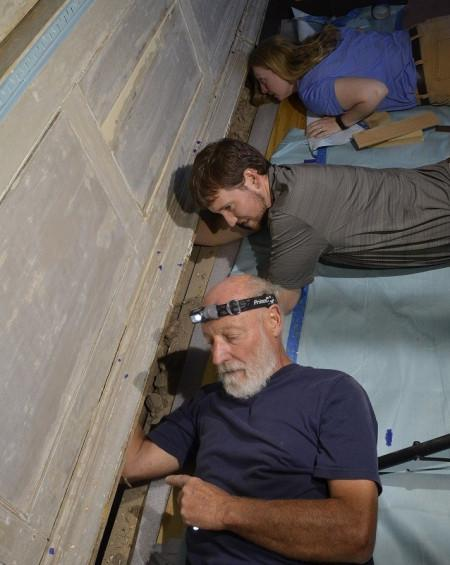 Investigating the framing behind the east wall of the Front Parlor. MVLA.