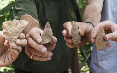 Volunteers display prehistoric artifacts excavated during the Slave Cemetery Survey.