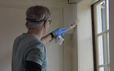 Painting the south window architrave.