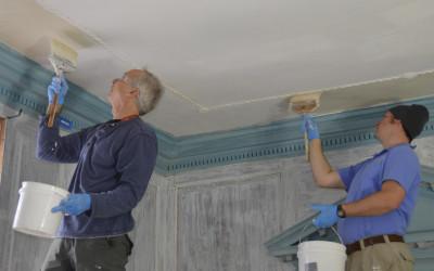 Whitewashing the ceiling.