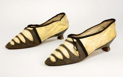 "Women's ""Grecian"" sandals, ca. 1792-1795. Black and white/yellow kid. Image (c) The Bata Museum, Toronto."