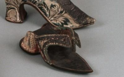 Clog, brocaded silk with applied silver trim, 1730s. Image (c) The Colonial Williamsburg Foundation.