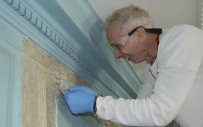 Paint removal from one of the east wall panels.