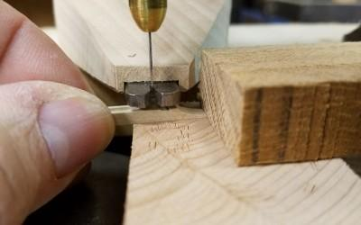 Plectrum mortises formed with piercing tool in drill press