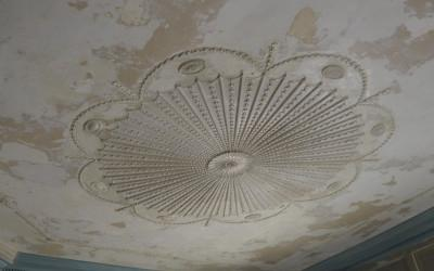Ceiling after paint removal with conservation underway.