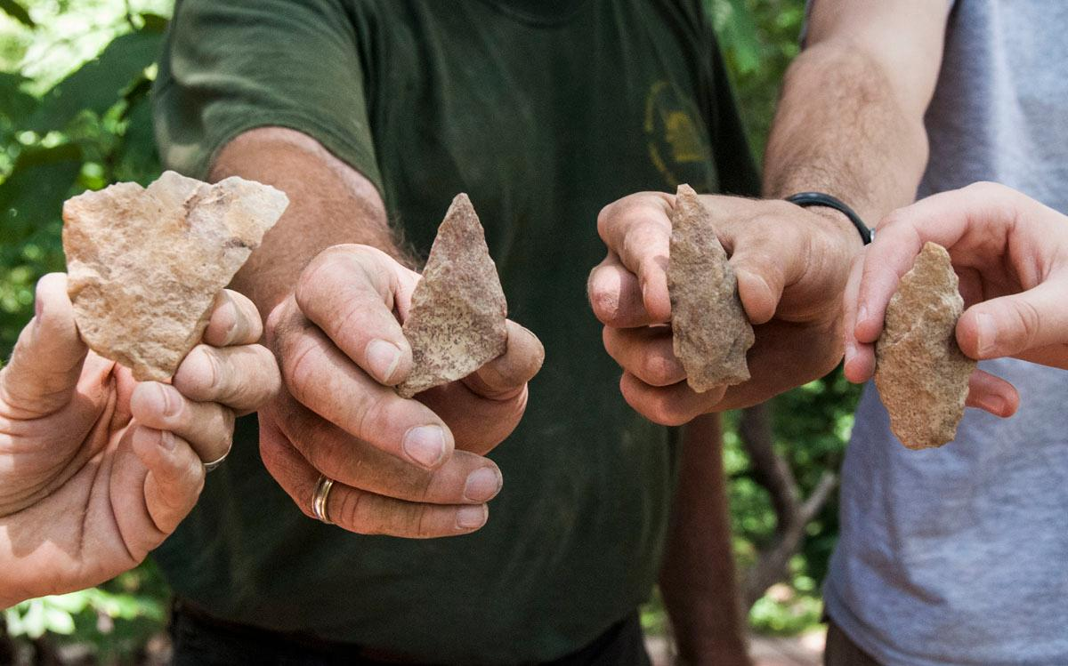 Stone tools and projectile points uncovered during the cemetery survey